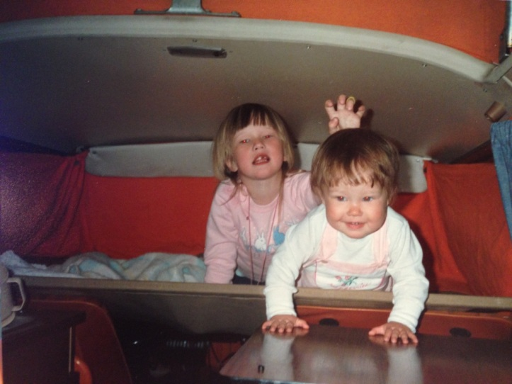 My sister and I playing in our parents VW Van.
