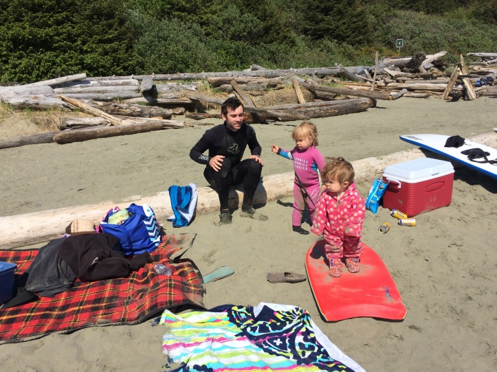 The girls and my husband playing on the beach after he just came in from surfing.