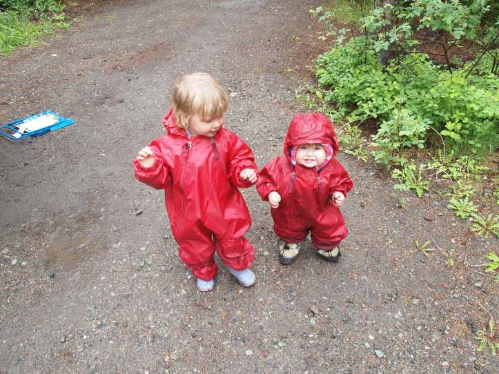 Girls in their Muddy Buddy on a rainy day.